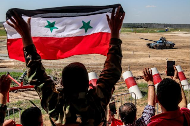 <p>Syrian military officers support their team during an individual race in Stage 1 of the Tank Biathlon Contest at the 2018 International Army Games in Alabino, Moscow region, Russia on July 31, 2018. (Photo: Sergei Bobylev/TASS via Getty Images) </p>