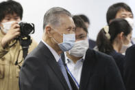 """Tokyo 2020 Organizing Committee President Yoshiro Mori arrives for the first meeting of the """"Tokyo 2020 New Launch Task Force"""" in Tokyo, Thursday, March 26, 2020, two days after the unprecedented postponement was announced due to the spreading coronavirus. (AP Photo/Koji Sasahara)"""