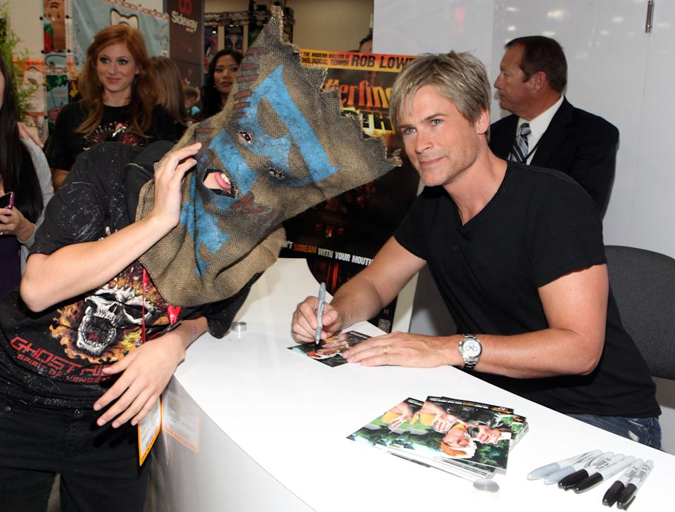 """Rob Lowe, director of """"Butterfinger the 13th,"""" is seen signing autographs for fans at Comic-Con International, in San Diego, Calif., Friday, July 22, 2011. (Casey Rodgers/AP Images for Butterfinger)"""
