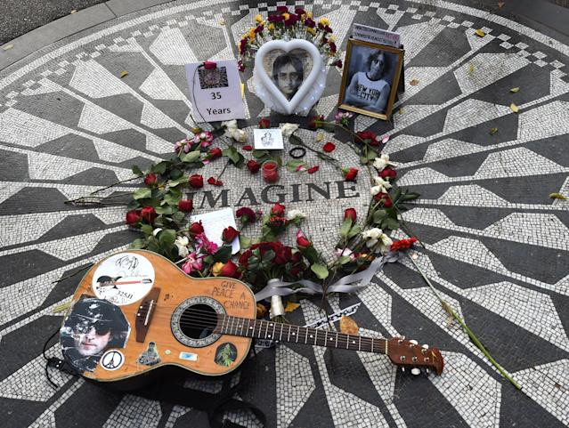 "Items left at the mosaic named for John Lennon's song ""Imagine"" at Strawberry Fields, the Central Park garden dedicated in his honor in New York. (Photo: Timothy A. Clary/AFP/Getty Images)"
