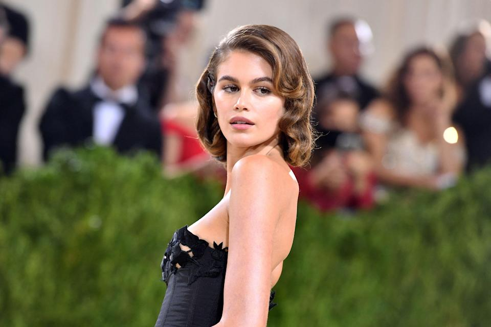 """US fashion model Kaia Gerber arrives for the 2021 Met Gala at the Metropolitan Museum of Art on September 13, 2021 in New York. - This year's Met Gala has a distinctively youthful imprint, hosted by singer Billie Eilish, actor Timothee Chalamet, poet Amanda Gorman and tennis star Naomi Osaka, none of them older than 25. The 2021 theme is """"In America: A Lexicon of Fashion."""" (Photo by Angela WEISS / AFP) (Photo by ANGELA WEISS/AFP via Getty Images)"""