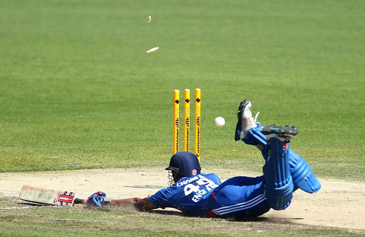 HOBART, AUSTRALIA - FEBRUARY 16:  Varun Chopra of the Lions bats narrowly avoids a run out during the international tour match between Australia 'A' and the England Lions at Blundstone Arena on February 16, 2013 in Hobart, Australia.  (Photo by Mark Nolan/Getty Images)