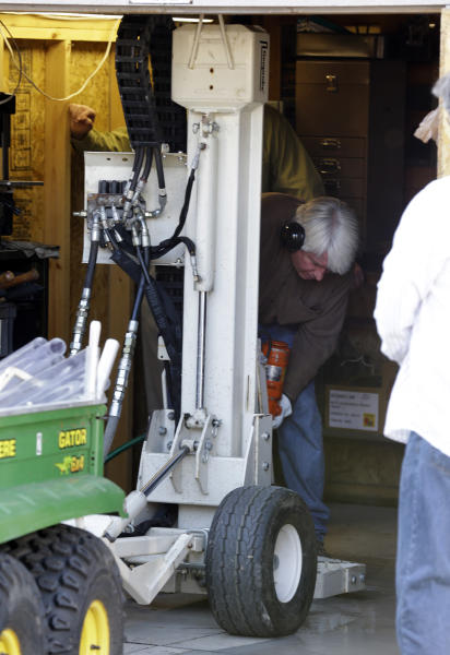 Authorities drill for soil samples in the floor of a shed at a Roseville, Mich., home Friday, Sept. 28, 2012. Police have been told by a source that former Teamsters boss Jimmy Hoffa may be buried beneath a driveway. (AP Photo/Paul Sancya)