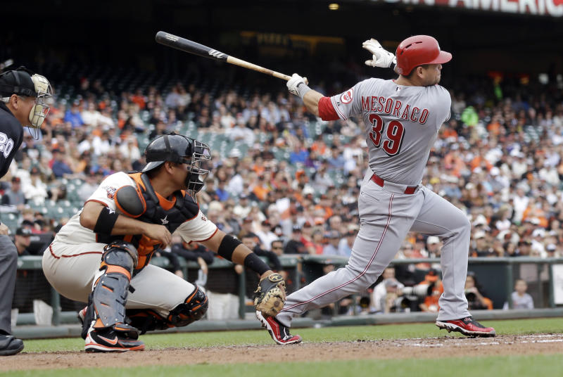 Cincinnati Reds' Devin Mesoraco (39) singles during the third inning of the first game of a baseball doubleheader against the San Francisco Giants on Tuesday, July 23, 2013, in San Francisco. (AP Photo/Marcio Jose Sanchez)