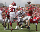 Georgia defensive back Dan Jackson blocks the punt in the end zone by Arkansas kicker Reid Bauer and Georgia recovered for the touchdown during the first quarter of an NCAA college football game on Saturday, Oct. 2, 2021, in Athens. (Curtis Compton/Atlanta Journal-Constitution via AP)