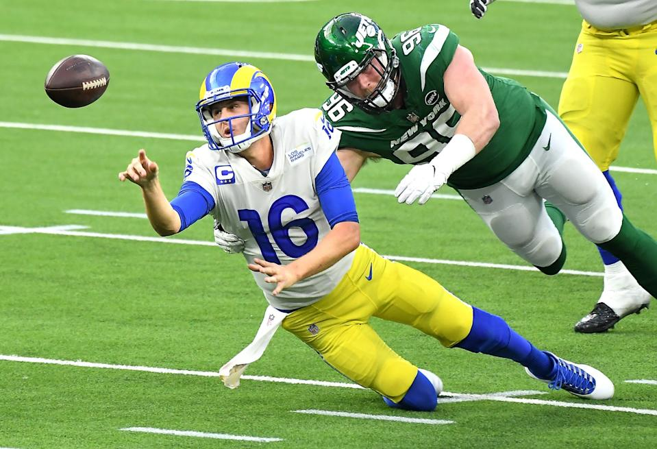Rams quarterback Jared Goff unloads the ball before Jets defensive lineman Henry Anderson piles on.