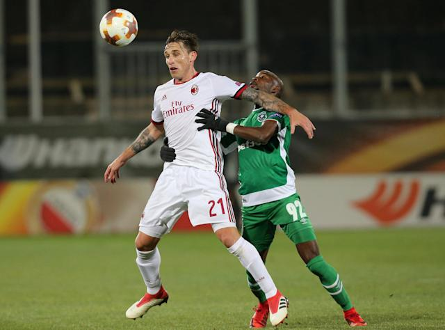 Soccer Football - Europa League Round of 32 First Leg - PFC Ludogorets Razgrad vs AC Milan - Ludogorets Arena, Razgrad, Bulgaria - February 15, 2018 AC Milan's Lucas Biglia in action with Ludogorets' Jody Lukoki REUTERS/Stoyan Nenov