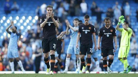 Hull City's Michael Dawson applauds fans after the match