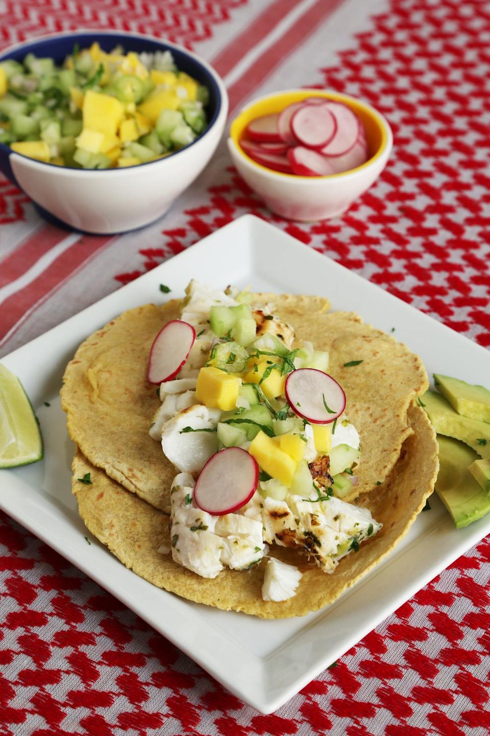 "<p>Choose a fish like halibut, sea bass, or striped bass, and marinate it for 15 minutes in lime juice and oil, and you're on your way to heavenly homemade fish tacos. </p> <p><strong>Get the recipe:</strong> <a href=""https://www.popsugar.com/food/Grilled-Fish-Tacos-Recipe-34643553"" class=""link rapid-noclick-resp"" rel=""nofollow noopener"" target=""_blank"" data-ylk=""slk:grilled fish tacos"">grilled fish tacos</a></p>"
