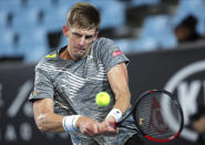South Africa's Kevin Anderson makes a backhand return to Ilya Ivashka of Belarus during their first round singles match at the Australian Open tennis championship in Melbourne, Australia, Tuesday, Jan. 21, 2020. (AP Photo/Andy Wong)
