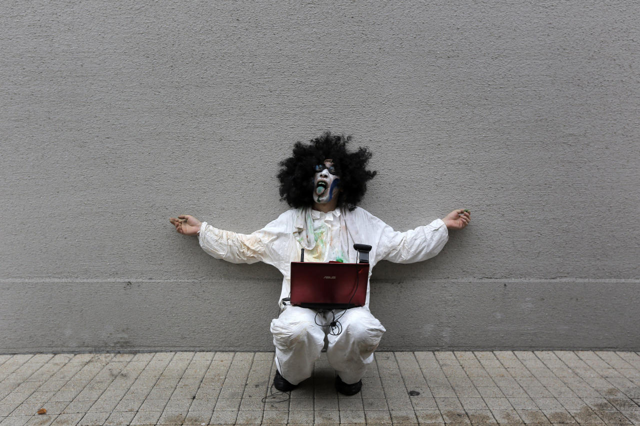 A costumed man performs at a Halloween event in Kawasaki, nearf Tokyo, Sunday, Oct. 28, 2012.(AP Photo/Itsuo Inouye)