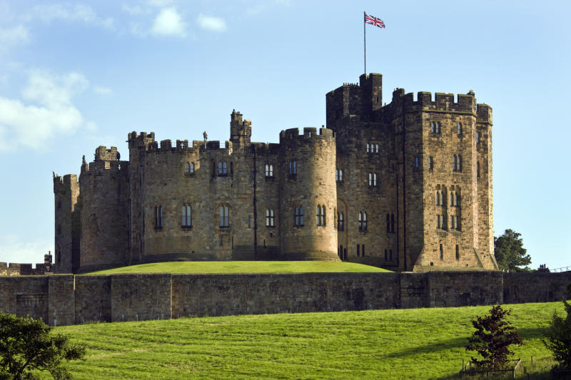 Alnwick, United Kingdom - July 29, 2008: Alnwick Castle in the town of Alnwick in Northumberland in North East England. Dates from 1096AD when Yves de Vescy became Baron of Alnwick and erected the earliest parts of the castle. Since 1309 the castle has been in the hands of the Percy Family who are the Dukes and Earls of Northumberland.