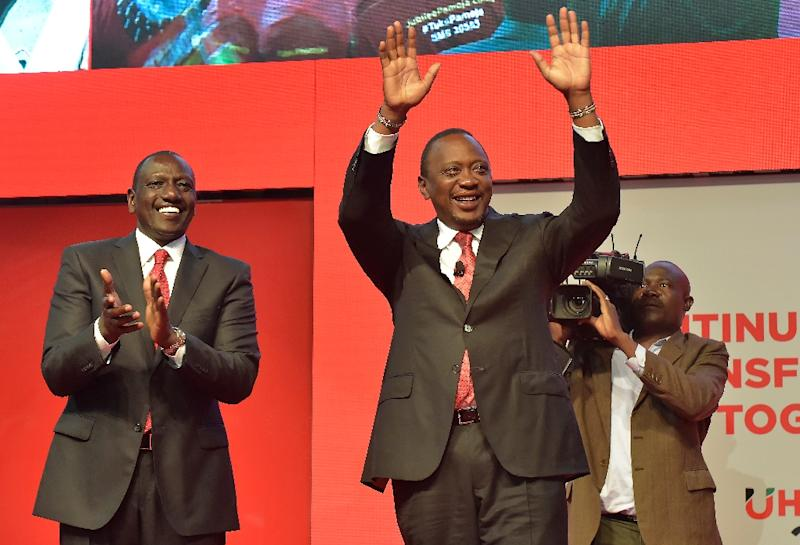 Deputy President William Ruto, left, with his running mate President Uhuru Kenyatta in June