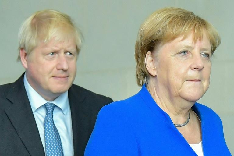"Merkel said perhaps an agreement would be possible within ""30 days"" (AFP Photo/Tobias SCHWARZ)"
