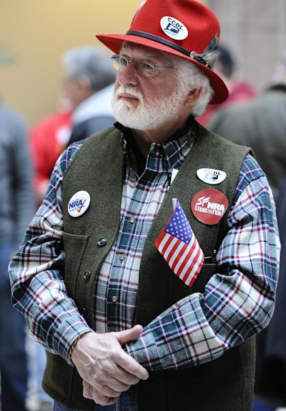 "Tom Smith of Cromwell, Conn., shows his support during a ""lobby day"" held by the National Rifle Association and other gun rights groups at the Legislative Office Building in Hartford, Conn., Monday, March 11, 2013. Both sides of the gun control issue are increasing pressure on Connecticut lawmakers who are close to voting on changes to state law stemming from the deadly shooting at Sandy Hook Elementary School in Newtown. (AP Photo/Jessica Hill)"
