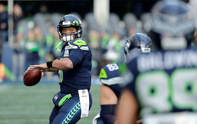 QB Russell Wilson led the Seahawks toward a wild-card berth last season. (AP)