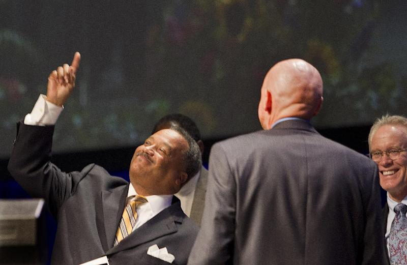 Rev. Fred Luter Jr. points upward after being re-elected as the Southern Baptist Convention's president during the 2013 Southern Baptist Convention Annual Meeting at the George R. Brown Convention Center Tuesday, June 11, 2013, in Houston. Luter was the SBC's first black president. (AP Photo/Houston Chronicle, Johnny Hanson)