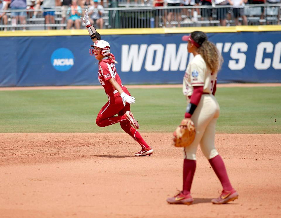 OU's Jayda Coleman (24) celebrates a home run in the second inning as Florida State's Elizabeth Mason (5) looks on during Thursday's Game 3.