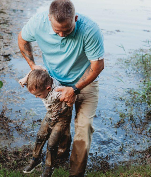The little boy ran into the muddy river before his family could catch him. [Photo: Caters]