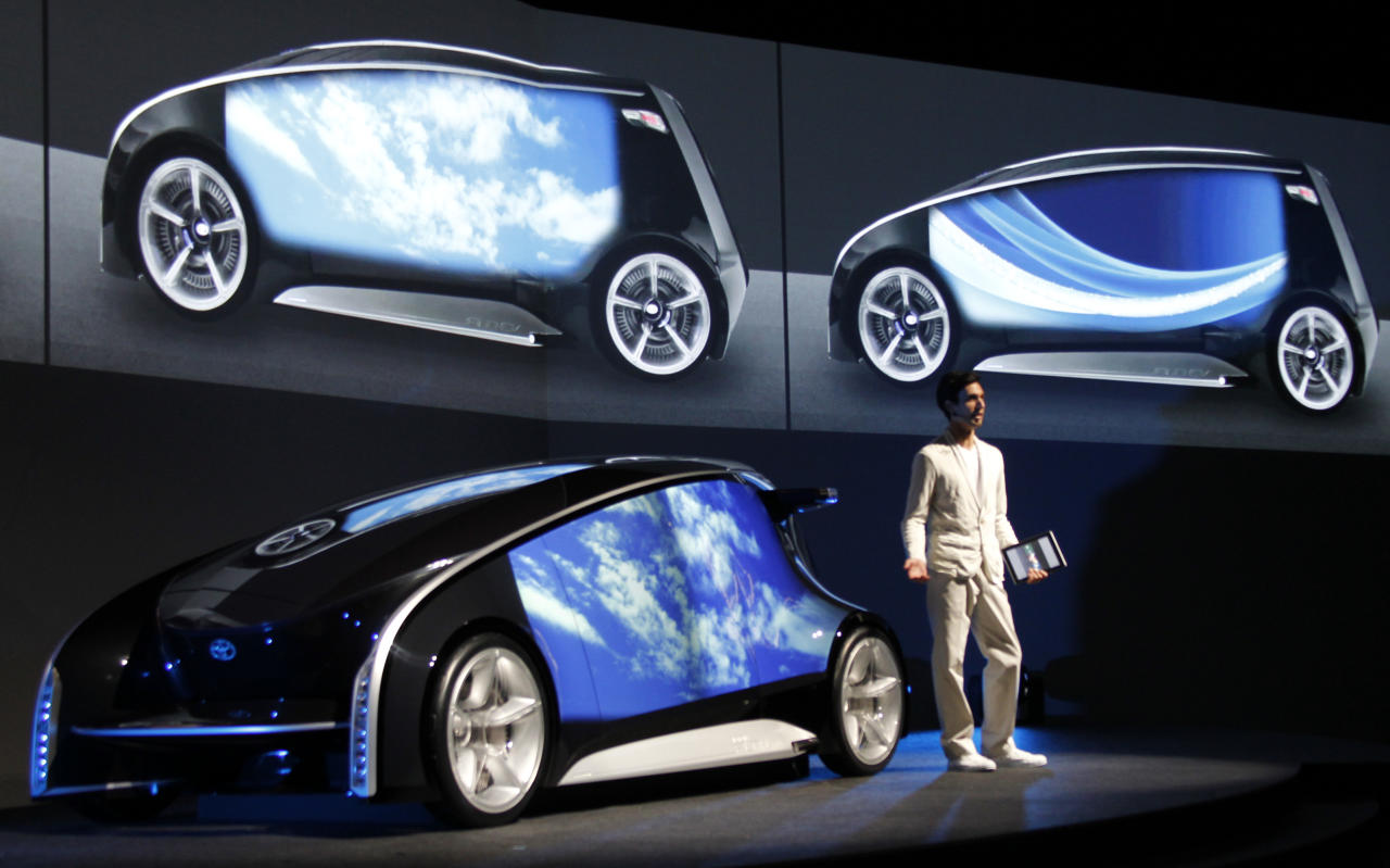 A presenter explains about Toyota Fun-Vii in Tokyo Monday, Nov. 28, 2011. Toyota Motor Corp. unveiled the futuristic concept car resembling a giant smartphone to demonstrate how Japan's top automaker is trying to take the lead in technology at the upcoming Tokyo auto show, which opens to the public this weekend. (AP Photo/Koji Sasahara)