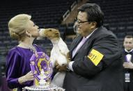 FILE - Judge Betty Regina Leininger, left, and handler Gabriel Rangel, pose with Sky, a wire fox terrier, after winning best in show at the Westminster Kennel Club dog show in New York, in this Tuesday, Feb. 11, 2014, file photo. In a competition that can include a Norwegian elkhound, Australian shepherd and Chinese shar-pei, the people come from all over the world, too. Born in Mexico, Gabriel Rangel is among the most successful handlers in history. (AP Photo/Frank Franklin II, File)