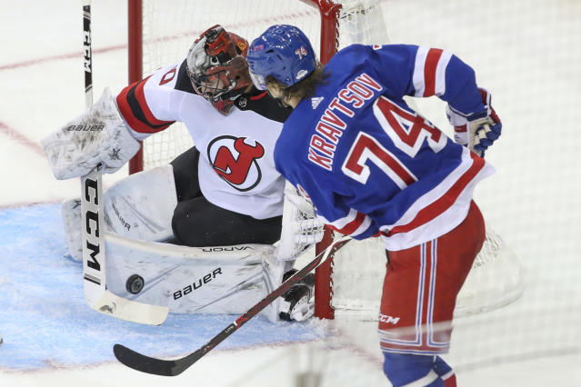 New Jersey Devils goaltender Evan Cormier (50) makes the save against New York Rangers right wing Vitali Kravtsov (74) during the third period of a preseason NHL hockey game Wednesday, Sept. 18, 2019, at Madison Square Garden in New York. (AP Photo/Mary Altaffer)