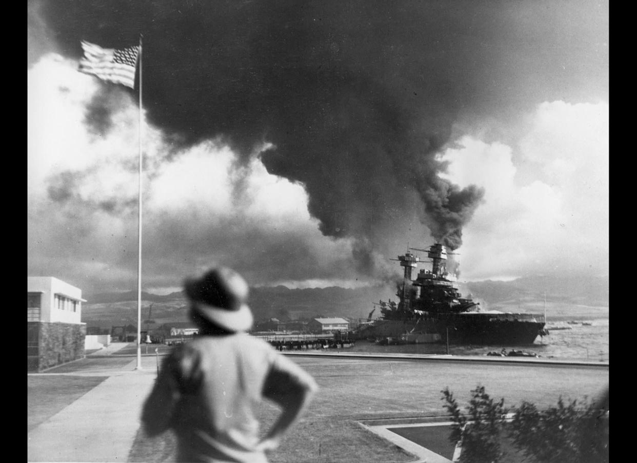American ships burn during the Japanese attack on Pearl Harbor, Hawaii, in this Dec. 7, 1941 file photo.