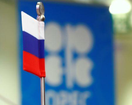 The Russian flag and the OPEC logo are seen before a news conference in Vienna, Austria, October 24, 2016.   REUTERS/Leonhard Foeger