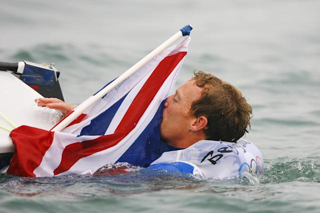 QINGDAO, CHINA - AUGUST 19: Paul Goodison of Great Britain celebrates overall victory in the Laser class event following the medal race held at the Qingdao Olympic Sailing Center during day 11 of the Beijing 2008 Olympic Games on August 19, 2008 in Qingdao, China. (Photo by Clive Mason/Getty Images)