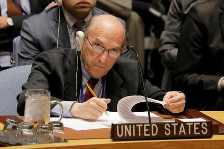 FILE PHOTO: United States diplomat Elliott Abrams takes notes during a meeting of the U.N. Security Council called to vote on a U.S. draft resolution calling for free and fair presidential elections in Venezuela at U.N. headquarters in New York, U.S., February 28, 2019. REUTERS/Lucas Jackson/File Photo