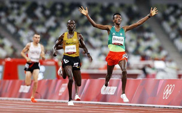 PHOTO: Selemon Barega of Ethiopia wins the men's 10000m final during the Athletics events of the Tokyo 2020 Olympic Games at the Olympic Stadium in Tokyo, Japan, July 30, 2021. (Valdrin Xhemaj/EPA-EFE/Shutterstock)