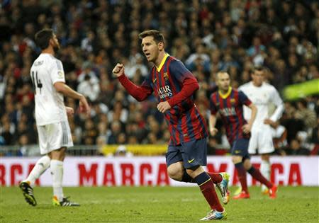 Barcelona's Lionel Messi celebrates after scoring a penalty against Real Madrid during La Liga's second 'classic' soccer match of the season at Santiago Bernabeu stadium in Madrid March 23, 2014. REUTERS/Sergio Perez