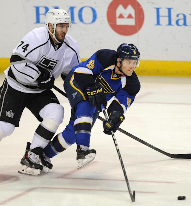 St. Louis Blues' Jaden Schwartz (9) passes in front of Los Angeles Kings' Dwight King (74) during the second period of an NHL hockey game on Thursday, Jan. 2, 2014 in St. Louis. (AP Photo/Bill Boyce)