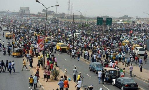 Thousands of protesters gather at Gani Fawehinmi Park in Lagos. Tens of thousands of protesting Nigerians defied an order to end a three-day-old strike Wednesday as unions threatened oil production and a mob rampaged in one city, leaving a police officer dead