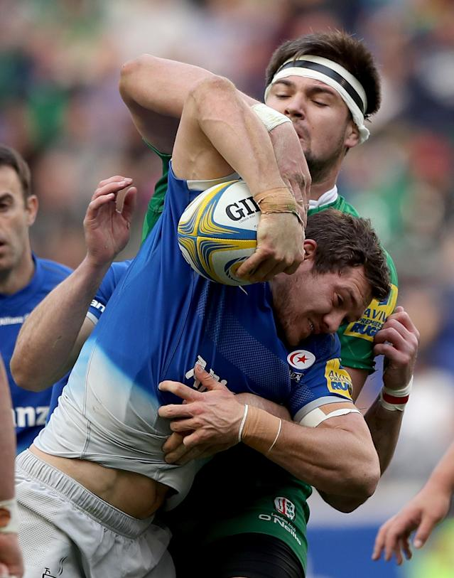 HARRISON, NJ - MARCH 12: Alex Goode #15 of Saracens carries the ball Matt Symons #4 of London Irish defends during the Aviva Premiership match on March 12, 2016 at Red Bull Arena in Harrison, New Jersey. (Photo by Elsa/Getty Images)