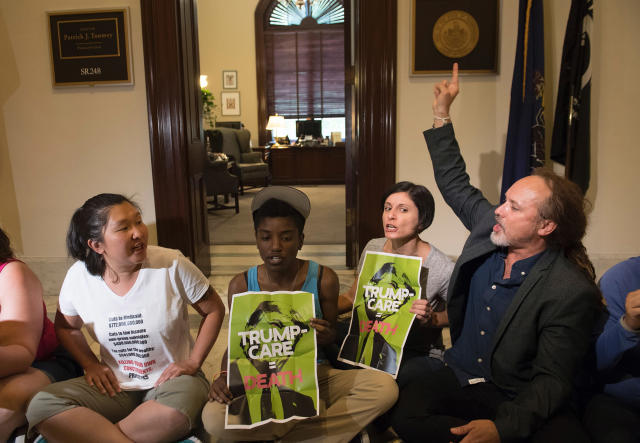 <p>Protesters of the Senate Republicans health care bill stage a sit-in outside the office of Sen. Patrick Toomey, Republican of Pennsylvania, on Capitol Hill in Washington, June 28, 2017. (Photo: Saul Loeb/AFP/Getty Images) </p>