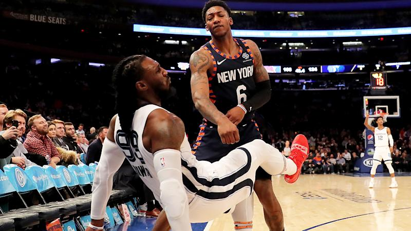 Elfrid Payton of the New York Knicks shoves Jae Crowder of the Memphis Grizzlies after he attempted a three point shot in the final minutes of the game at Madison Square Garden. (Photo by Elsa/Getty Images)