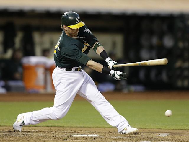 Oakland Athletics' Josh Donaldson hits an RBI ground out off Seattle Mariners' Aaron Harang in the fourth inning of a baseball game, Monday, Aug. 19, 2013, in Oakland, Calif. (AP Photo/Ben Margot)