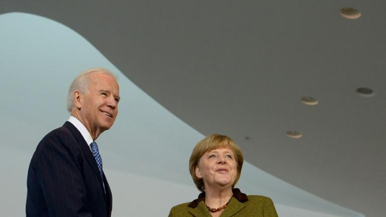 In a flurry of calls, US President-elect Joe Biden (L, pictured 2013) also spoke to German Chancellor Angela Merkel and French President Emmanuel Macron