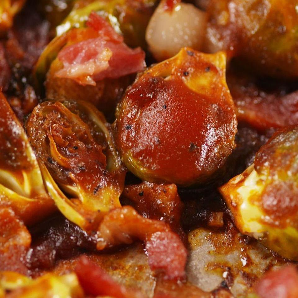 """<p>Brussels just got an upgrade! </p><p>Get the <a href=""""https://www.delish.com/uk/cooking/recipes/a35010195/bacon-bbq-brussels-sprouts-recipe/"""" rel=""""nofollow noopener"""" target=""""_blank"""" data-ylk=""""slk:Bacon BBQ Brussels Sprouts"""" class=""""link rapid-noclick-resp"""">Bacon BBQ Brussels Sprouts</a> recipe.</p>"""