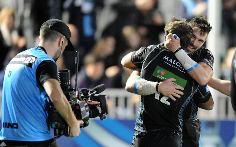 Glasgow Warriors winger celebrates his second half try with Peter Horne - Credit: Rex