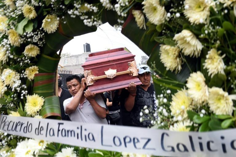 Relatives carry a coffin with the remains of Juan Luis Diaz Galicia, who was among the victims