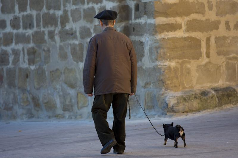 SPAIN - SEPTEMBER 15: Old man walking his chihuahua dog in the streets of Laguardia, Northern Spain (Photo by Tim Graham/Getty Images)