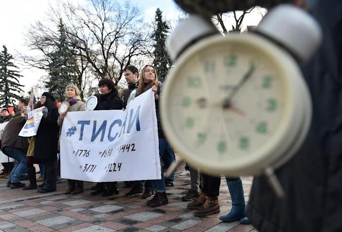 Gay rights activists call time on discrimination in a protest outside the Ukrainian parliament in Kiev on November 12, 2015 (AFP Photo/Sergei Supinsky)
