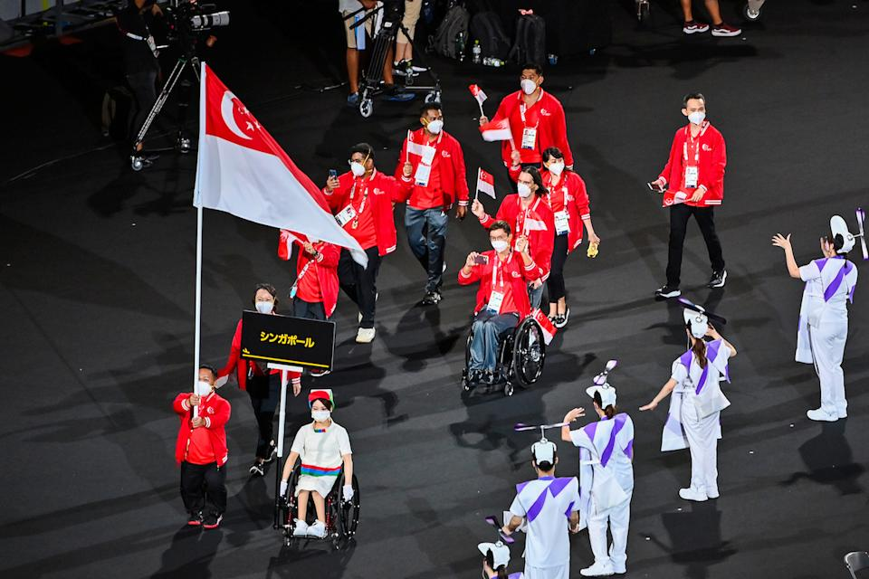 The Singapore contingent led by flag bearer Muhammad Diroy Noordin enter the Olympic Stadium during the 2020 Tokyo Paralympics opening ceremony. (Photo: Sport Singapore)