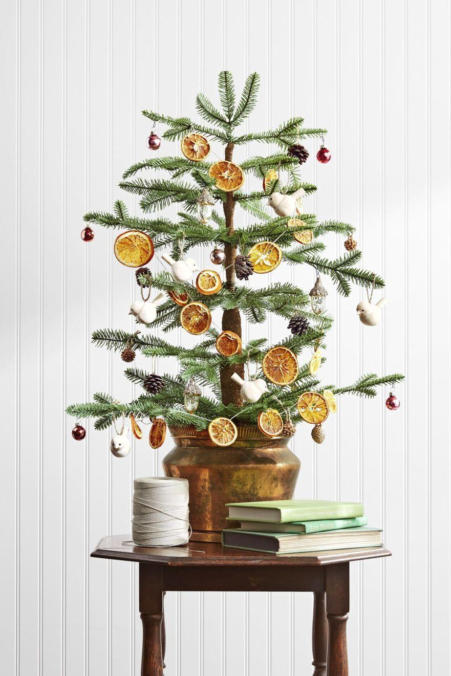 """<p>For a fun and unexpected twist, use twine, nylon thread, or wire to add dried citrus to your garland.</p><p><strong>RELATED</strong>: <a href=""""https://www.goodhousekeeping.com/holidays/christmas-ideas/g393/homemade-christmas-ornaments/"""" rel=""""nofollow noopener"""" target=""""_blank"""" data-ylk=""""slk:The Best Christmas Ornaments to Make This Season"""" class=""""link rapid-noclick-resp"""">The Best Christmas Ornaments to Make This Season</a></p>"""
