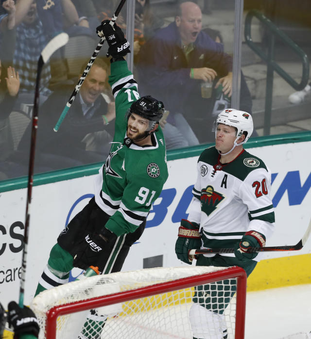 Dallas Stars center Tyler Seguin (91) celebrates his goal, next to Minnesota Wild defenseman Ryan Suter (20) during the third period of an NHL hockey game in Dallas, Friday, Feb. 1, 2019. The Stars won 3-1. (AP Photo/LM Otero)