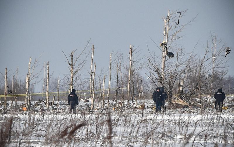 Emergency workers searched for remains of the plane, with wreckage spread over more than 30 hectares (AFP Photo/Vasily MAXIMOV )