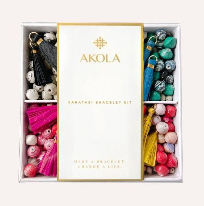 """<p>akola.co</p><p><strong>$49.99</strong></p><p><a href=""""https://go.redirectingat.com?id=74968X1596630&url=https%3A%2F%2Fakola.co%2Fcollections%2Fjust-in%2Fproducts%2Fbead-kit&sref=https%3A%2F%2Fwww.countryliving.com%2Fshopping%2Fgifts%2Fg2077%2Fchristmas-presents%2F"""" rel=""""nofollow noopener"""" target=""""_blank"""" data-ylk=""""slk:Shop Now"""" class=""""link rapid-noclick-resp"""">Shop Now</a></p><p>Give a gift that gives back this year, like this bracelet kit which helps employ Ugandan women in poverty. </p>"""