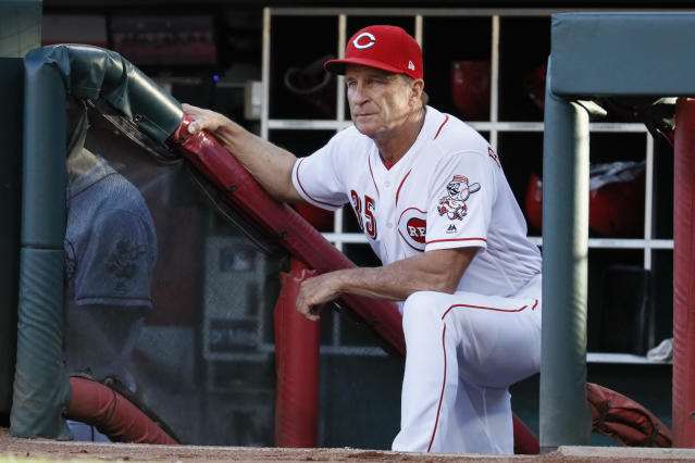 Cincinnati Reds interim manager Jim Riggleman stands in the dugout during the second inning of the team's baseball game against the Pittsburgh Pirates, Wednesday, May 23, 2018, in Cincinnati. (AP Photo/John Minchillo)